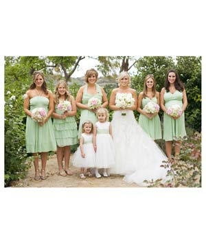Bridal party with bridesmaids in different mint green dresses