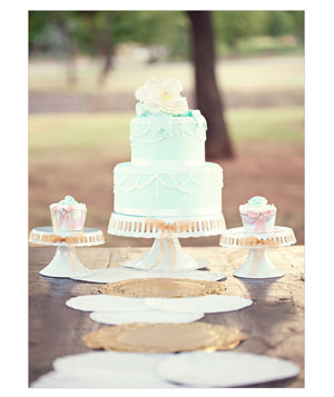 Wedding cake with mint green fondant and two matching cupcakes