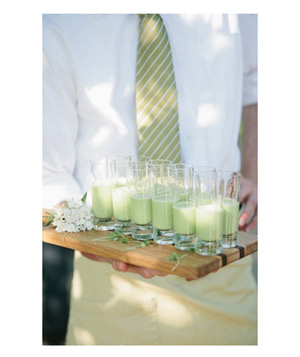 Tray of mint green cocktails at wedding