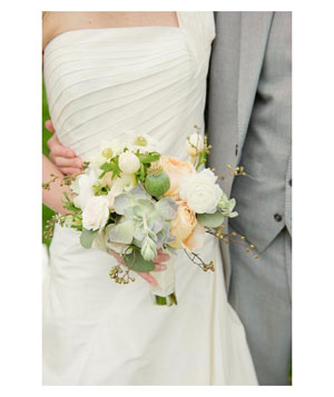 Muted bridal bouquet with pale roses and succulents