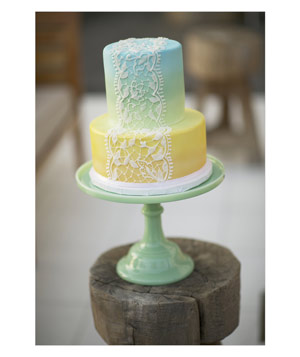 Ombre two-tier wedding cake on mint green stand