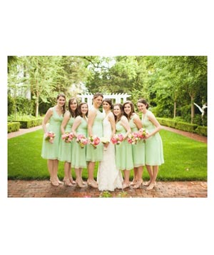 Bridal party outside with bridesmaids in mint green with pink bouquets