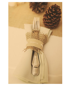 Rustic table setting with pinecone and burlap