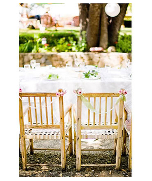 Outdoor wedding table setting accented with flowers