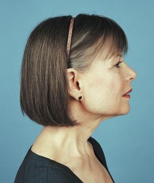 Profile of woman with bob in skinny metallic headband