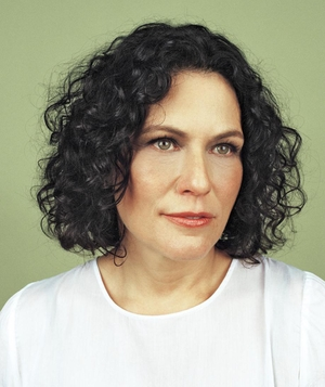 Woman with chin-length curly bob