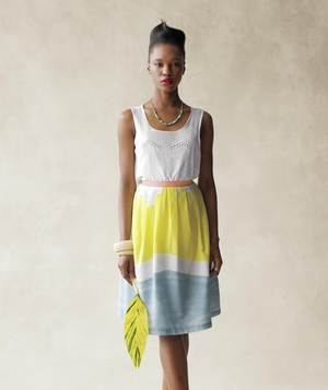 Model wearing white eyelet top and watercolor skirt