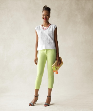 Model wearing white top and lemon yellow capri pants