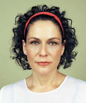 Woman with curly bob in wraparound headband