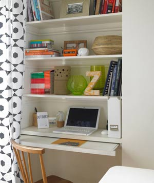 Shelving unit transfomed into office space with curtain