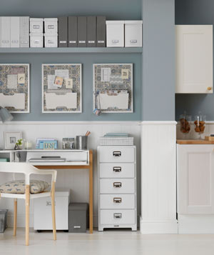 Gray And White Home Office Space Adjacent To Kitchen