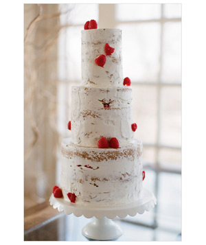 Three-tier red and white wedding cake