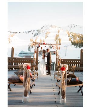 Wedding couple with snowy mountain backdrop
