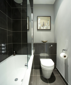 Bathroom with gray walls and black large tiles