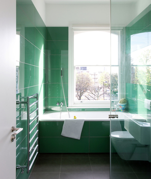 Bathroom with floor-to-ceiling green tiles