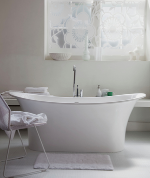 White airy bathroom with freestanding bathtub