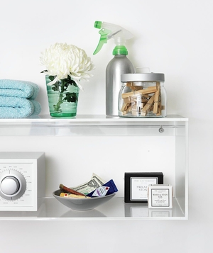 White shelves with spray bottle, clothespins, radio, towels