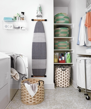 Laundry room with ironing board, large hamper, shelves