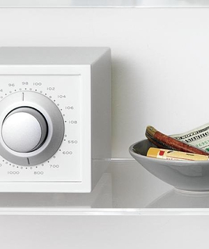 Radio and tray on laundry shelf