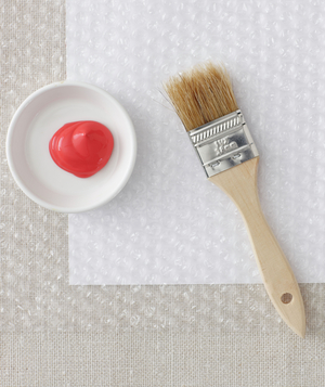 Supplies for decorating vase with paint and bubble wrap