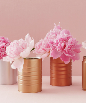 Centerpiece of pink peonies in spray-painted cans