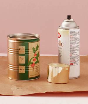 Tin can and copper spray paint on butcher paper