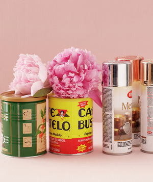 Cans of spray paint, tin cans, and pink peonies