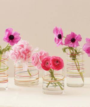 Centerpiece Of Flowers In Vases Decorated By Rubber Bands