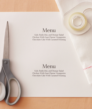 Paper with menus printed, cloth napkins, and scissors