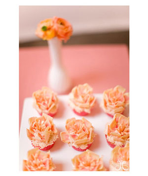 Cupcakes decorated with sugar orange peonies