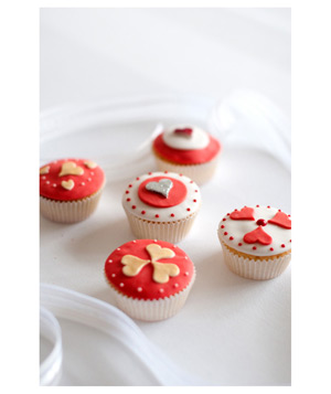 Cupcake assortment with designs of red and white frosting