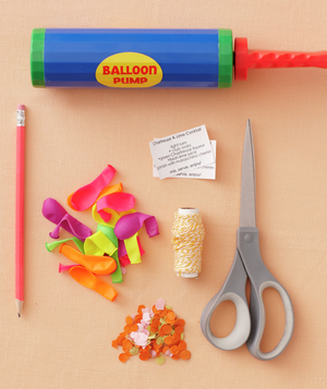 Balloon pump, string, scissors, small menus, pencil, mini-balloons, confetti