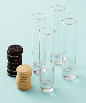 Hi-ball glasses next to vanilla and chocolate cookies