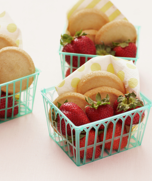 Strawberries in baskets with cookies