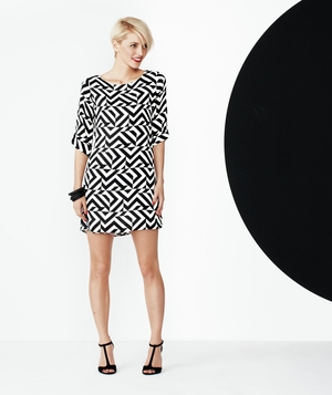 Model wearing black and white print Everly dress