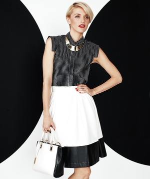 Model wearing black and white Kate Spade top and black and white colorblocked Calvin Klein skirt