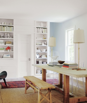 Dining room with bench, lucite chairs, bookshelves