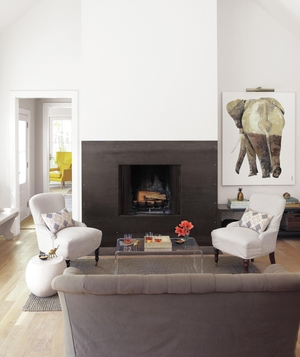 White, gray and black living area with fireplace, elephant painting