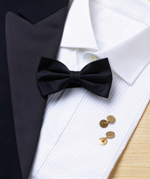 Dinner jacket, shirt and black bowtie