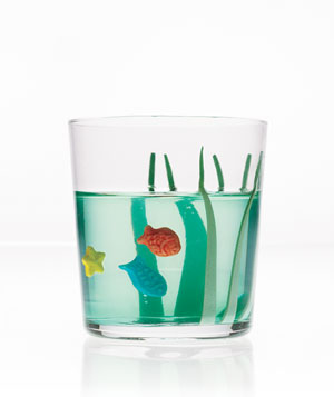Small green gelatin aquarium with sea grass and colored candy fish