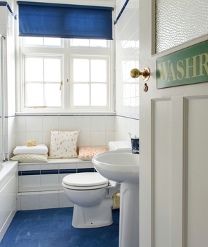 White bathroom with blue shade and floor