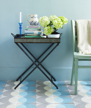 Light blue hallway with table and chair