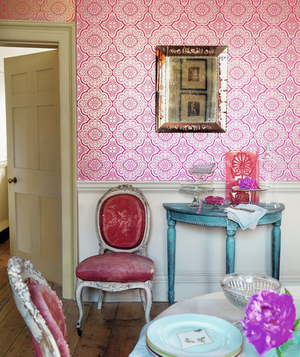 Fuchsia paper with a medallion print on a dining room wall
