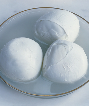 Three mozzarella balls in clear bowl