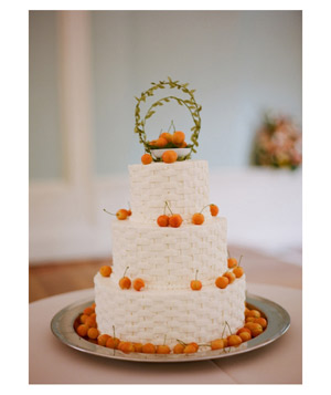 Wedding cake with woven texture decorated with cherries