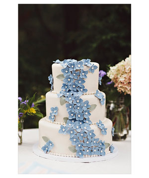 3-tiered wedding cake with blue flower decorations