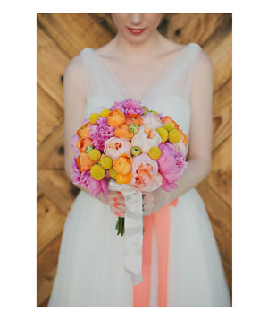 Bride with bouquet of ranunculus and peonies