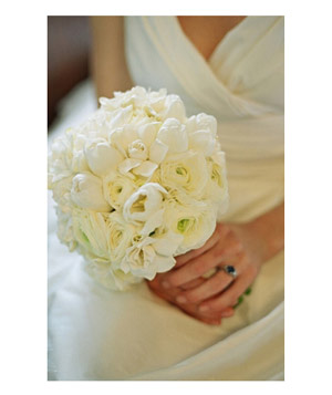 Bride with bouquet of white ranunculus