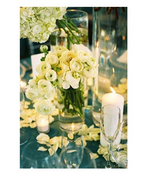 Wedding table vase with pale yellow ranunculus