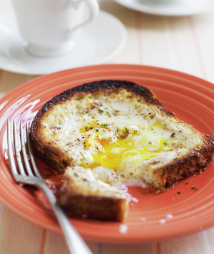 Egg cooked into toast
